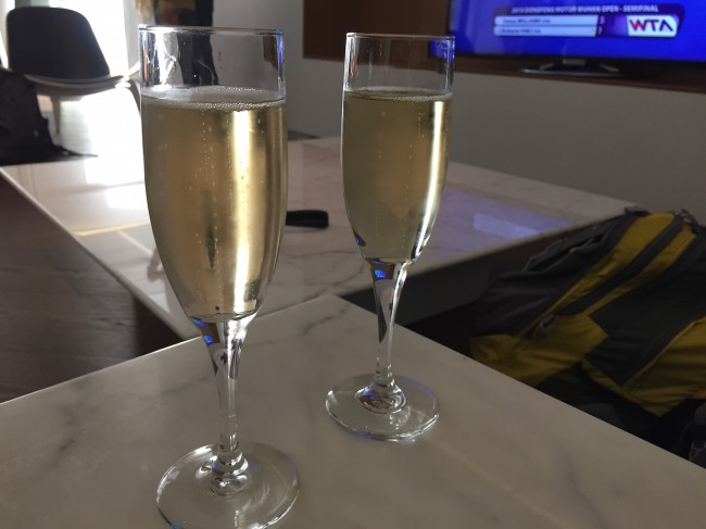 """Champagne in Cathay Pacific """"The Wing"""" Lounge"""